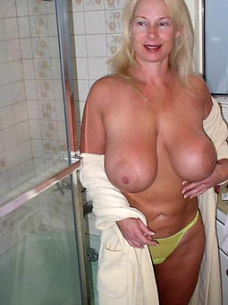 old lady broad in the beam boobs stripping
